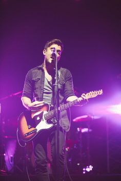 Phil Wickham.....yeah i pinned this cuz the background was an awesome Purple and the person in front is an awesome singer<3