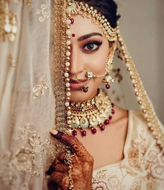Perfect finishing to a bridal look is given by stunning nose rings! Book the best makeup artist now with BookEventZ to get the perfect bridal look on THE DAY! Indian Bride Photography Poses, Indian Bride Poses, Indian Wedding Poses, Indian Bridal Photos, Wedding Couple Poses Photography, Bridal Photography, Indian Wedding Pictures, Bengali Wedding, India Wedding