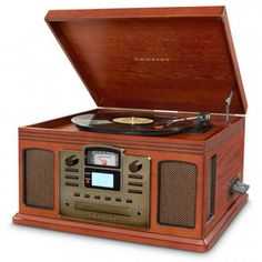 Turn albums and cassettes into digital format and CDs. Or simply listen to LPs, tapes, AM/FM radio and even your music device on the Crosley Director CD Recorder. Best Director, Any Music, Record Players, Billiard Room, Dot And Bo, My New Room, Furniture Collection, Jukebox, Turntable
