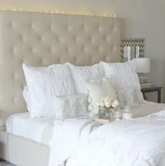 This is what we call the ultimate white bed. Designer @kelleynan has created a white bedroom oasis that we can just imagine sinking into at the end of the night. We especially like the twinkle lights around the headboard! #mypotterybarn