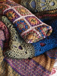 Color Inspiration :: Beautiful granny square throw in Rowan Pure Life wool   . . . .   ღTrish W ~ http://www.pinterest.com/trishw/  . . . .  #crochet #afghan #blanket #throw