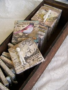 These little charmings, as I call them are so much fun to make, and I think they will be even more fun to collect and display in a grouping of 3 or more. This mini collage is made up of a tiny stretched canvas, collage papers, layers of distressed paints and waxes, and finally a beautiful vintage image of a colorful bird. Words have also been added for interest. Measuring just under 3 inches square, with a black wire hanger attached at the top, it would fit in anywhere you might need a…