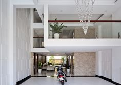Tropical Sunlight Filtering House was implemented by Cong Sinh Architecture company in 2014.