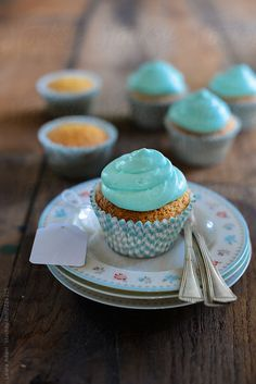 cupcakes with lightblue frosting by LauraAdani | Stocksy United
