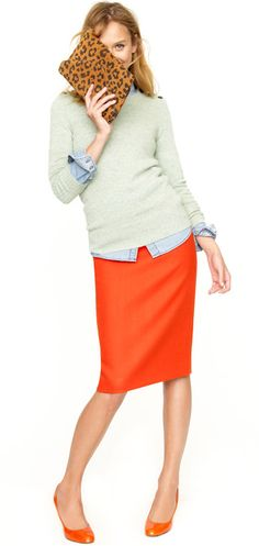 Love the fitted crewneck over the untucked button down. Hate the pencil skirt.