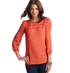 like the shape - not sure about the color but would look good with white jeans & gold