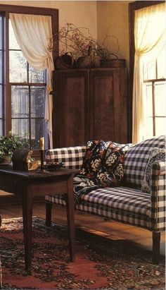 Country Prim...corner cupboard, table, window treatments & checked sofa.  Love it all!