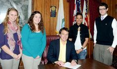 FCLA members watch as Washington Mayor Ames Barnett signs the proclamation for FBLA-PBL Week.