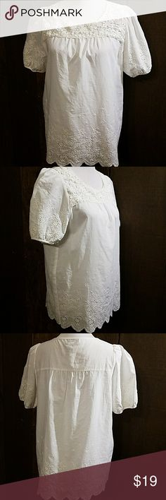 """Lauren Michelle embroidered eyelet top RUNS LARGE Lauren Michelle embroidered eyelet top is a great way to start off your Spring and Summer wardrobe! Measures 40"""" bust 44"""" waist 11"""" sleeves and is 26"""" long in excellent condition! Lauren Michelle Tops Blouses"""