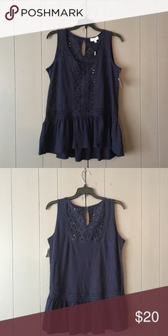 """Adorable Navy Peplum tank✨Brand new✨ Super cute details on this adorable tank! Hi low style. Armpit to armpit is 18.5"""". Tops"""