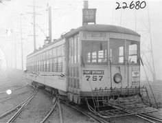 Seattle Streetcar 757, 1929. The street car's destination is Barn - Fremont. Attached to the streetcar is poster for a Stanford vs. University of Washington football game.