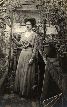 Lovely shot inside a small glasshouse in 1909; Arts and Crafts era women's clothing