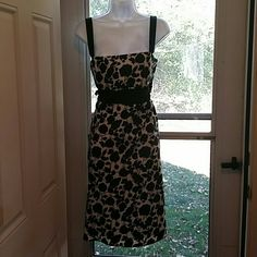 Beautiful black and white BCBG dress. 97% cotton 3% spandex material. This dress was only worn twice and is very comfortable but fits snug in all the right places. BCBG Dresses Midi