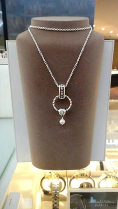 PANDORA. Necklace with Ring as Pendant, Double Clip and Pearl Clip.
