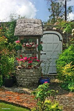 Wishing well, and wonderful gate/door in wall - Cottage Garden, Devon, England