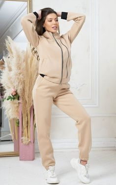 Pants suit set for women by Olesya Masyutina. Consists of oversize zip-up sweatshirt and jogger pants on the cuff, warm Turkish footer with fleece, winter suit. 800 models of knitted and fabric women clothes in casual style, evening and wedding