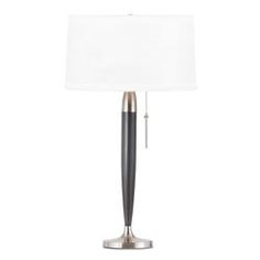 Shorter yet just as functional as its taller sibling, the Abella Table Lamp is a good choice for any room. The vintage-inspired lamp's bulb is housed inside a perfectly round shade for that soft warm glow and supported by a shorter yet sleek pole that tapers at the bottom. The lamp is attached to a sleek metal base and it has a simple pull chain. Set it on top of your office table or on a glass end table and you're all set