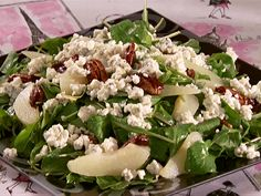 Arugula Salad with Pears and Gorgonzola from FoodNetwork.com / Add Spinach, use fresh pears, add some canned juice to dressing