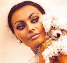 accessorize with earrings and a poodle!.. nice makeup