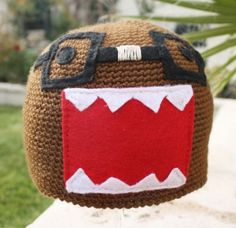 As if any crochet Domo hat weren't nerdy enough, Etsy seller littlepopos opted to make Domo in his excellent nerd incarnation, complete with tape on his glasses.