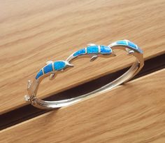 I'm auctioning 'Beautiful Jumping Ocean Dolphins Blue Fire Opal  Bangle Bracelet' on #tophatter