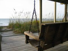 Two of my  favorites things...beach and a porch swing! Now put these in Scotland and I am there!