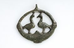Pentant Bronze The pendant is shaped as a fire-steel with two birds facing each other in the middleFindspot: Björkö, Adelsö, Uppland, Sweden