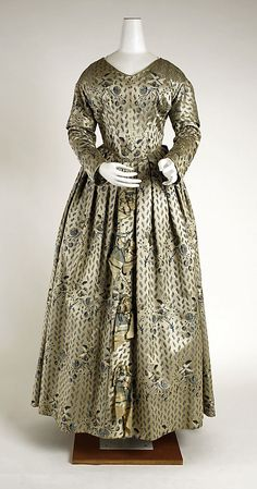 Dress  Date: ca. 1840 Culture: French Medium: silk Dimensions: Length at CB: 54 in. (137.2 cm) Length at CF: 48 1/2 in. (123.2 cm) Width at Bottom: 123 in. (312.4 cm) Credit Line: Gift of Mrs. William Bamberger, 1946 Accession Number: C.I.46.23