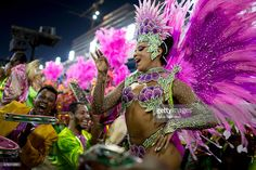 Queen of Percussion Evelyn Bastos of Mangueira celebrates during their parade at 2014 Brazilian Carnival at Sapucai Sambadrome on March 02, 2014 in Rio de Janeiro, Brazil. Rio's two nights of Carnival parades begin on March 2 in a burst of fireworks and to the cheers of thousands of tourists and locals who have previously enjoyed street celebrations (known as 'blocos de rua') all around the city.