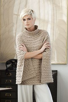 """Cabled Poncho by Norah Gaughan - Vogue Knitting Winter Take loungewear to the next level. NORAH GAUGHAN's sumptuous poncho is worked side to side in a rib-and-cable pattern with Berroco's """"Blackstone Tweed Metallic. Vogue Knitting, Loom Knitting, Knitting Needles, Free Knitting, Knitted Poncho, Crochet Shawl, Knit Crochet, Knit Shrug, Crochet Granny"""