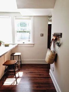 dark wood floors and off white walls