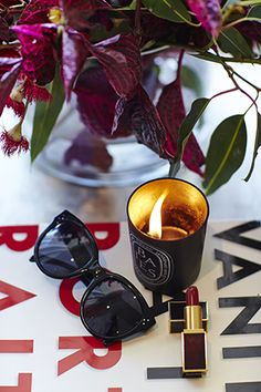 Luxe love; chic Celine sunnies, Diptyque, Tom Ford lippie, and intense pinks from the florals