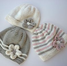 An easy to knit baby hat with a cute flower embellishment. This is really three patterns rather than one!! Instructions are given for a three colour stripe version, a ridged stripe version and a solid color version. If you are a relatively new knitter, there are plenty of step by step pictures to help you.The hat is knit in double knit yarn and the pattern gives instructions for 4 sizes from birth to 2 years #knittingpatternscute