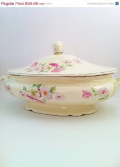 Virginia Rose Covered Casserole by Homer Laughlin. We found it in a box of dishes at a yard sale for $5.00