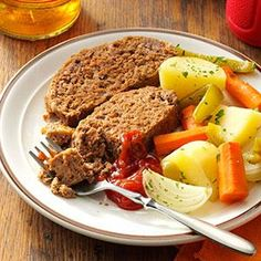 Pot Roast Meat Loaf   1 can (5 ounces) evaporated milk 1/4 cup ketchup 1/2 cup crushed saltines 2 tablespoons Worcestershire sauce 1/2 teaspoon salt 1/4 teaspoon pepper 2 pounds ground beef 4 small onions,  4 small potatoes,  4 medium carrots,  1 large green pepper,  Place the onions, potatoes, carrots and green pepper around the loaf. Cover and bake at 350° for 1-1/4 hours. Uncover; bake 15 minutes longer