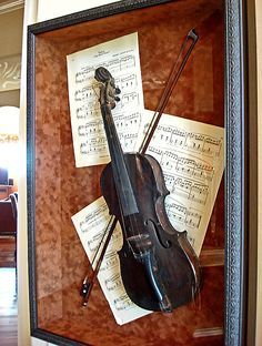 Nice way to display a keepsake - My Husbands Grandfathers old violin in a shadowbox along with some very old sheet music.