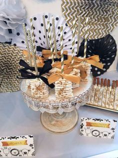 Rice Krispie treats at a white, black and gold baby shower party! See more party planning ideas at CatchMyParty.com!