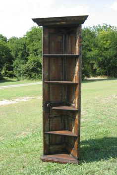 A corner bookshelf from an old door. So cool!