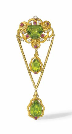A MID-19TH CENTURY PERIDOT, RUBY AND DIAMOND BROOCH