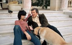 Keith Richards at home in his villa Nellcôte in the South of France with a friend and his dog Boogie, Summer 1971.