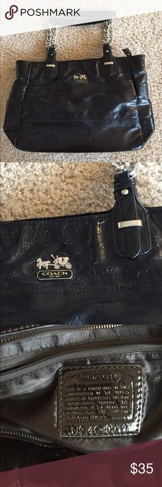 Coach black shoulder bag purse silver detail Coach purse / shoulder bag. Medium size . Black with silver detail. This was a gift so idk much about this purse so that's  reflected in price. Great condition but the zipper pull is missing but the zipper is still functional. See photo. Coach Bags Shoulder Bags