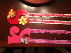 DIY girls barrette, bow and headband holder. Bought letter at hobby lobby ($3), spray painted, hot glued wooden figures ($0.67) to tops of letters. Hot glued two ribbons to each other, then hot glued to back of letters. Allow loops in one side when glueing to how headbands. Great gift for little girls.