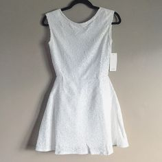 Sleeveless white sequin dress with low back NWT Tobi white sequin dress. Very pretty and sparkly. Sleeveless and low back. Size small. ❌ no trades. Tobi Dresses Mini