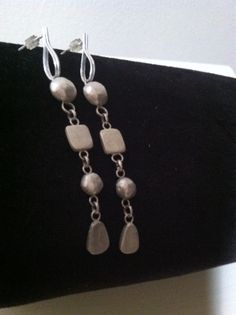 # sterling silver handcrafted earrings. I melted left over silver from other projects to make this earrings.