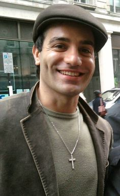 HIs face is so cute in this photo! Love the hat, Ramin!