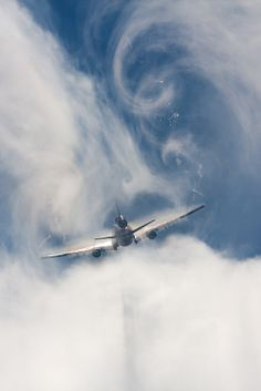 Martinair MD-11 Breaking through the clouds