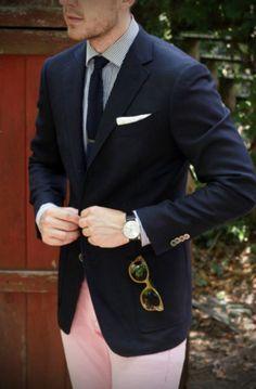Navy sport coat, white shirt with navy dress stripes, navy knit tie, pink pants