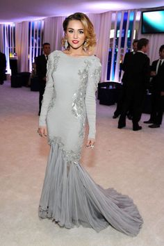 Miley Cyrus  in Roberto Cavalli at the 20th Annual Elton John AIDS Foundation Academy Awards Viewing Party. See all of the singer's wild looks.
