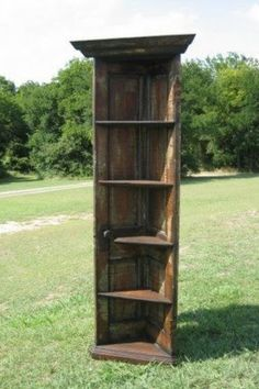 A corner bookshelf from an old door. So cool!@Jodie