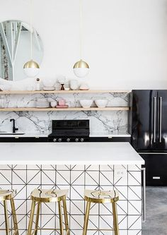 A tiled kitchen island, a beautiful marble backsplash and a natural stone floor - what's not to like?
